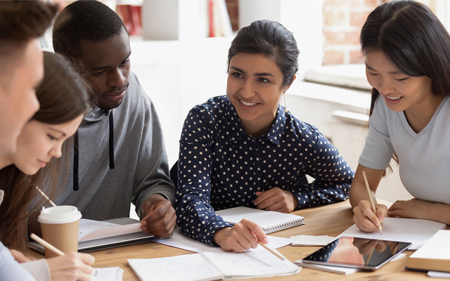 group of diverse students studying together